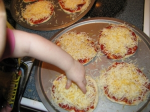 belle-putting-cheese-on-pizza