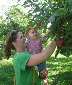 missy and angel picking apples