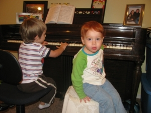 angel and noah playing piano