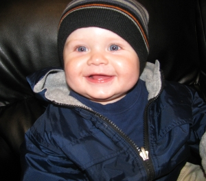 caleb smiling in coat 2