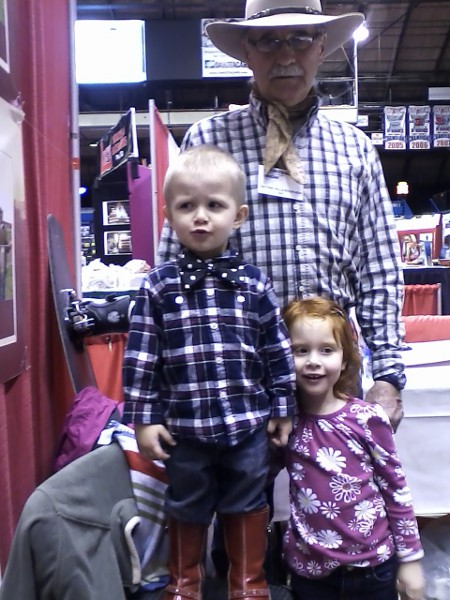 dad and kids at show